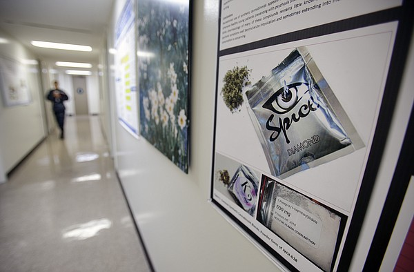 A poster at the Naval Medical Center San Diego in Balboa Park warns of the ef...