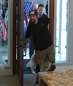 Former Marine Sgt. Nick Kimmel opens the door to his new home in Fallbrook, J...