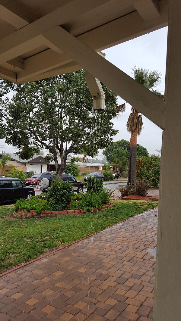 Rain falling from a gutter at a home in the El Cerrito ne...