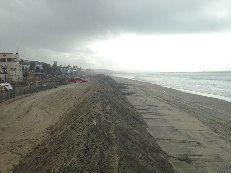 Officials are hoping the sand berms in Mission ...