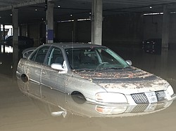 Two dozen cars remain submerged in flood waters at the Fashion Valley mall, J...