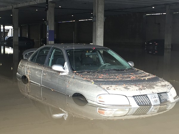 Two dozen cars remain submerged in flood waters at the Fa...