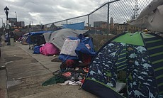 Dozens of people hunker down in tents on 16th S...