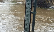 The San Diego River near Fashion Valley measured 10 feet on Thursday morning, with water peaking at its brim and overflowing in some sections, Jan. 7, 2016.