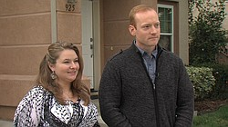 Daniel and Gloria Burke wait outside the home they would like to rent in Chul...