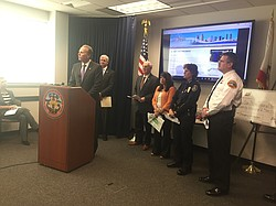 San Diego mayor Kevin Faulconer stands with other city and county leaders to discuss recent El Niño storms and to urge the public to prepare, Jan. 11, 2016.