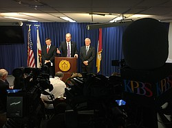 Mayor Kevin Faulconer talks to reporters about the next move in city negotiations with the San Diego Chargers after the NFL rejected the team's proposal to move to Carson, Jan. 13, 2016. Also shown are county Supervisor Ron Roberts, right, and City Attorney Jan Goldsmith.