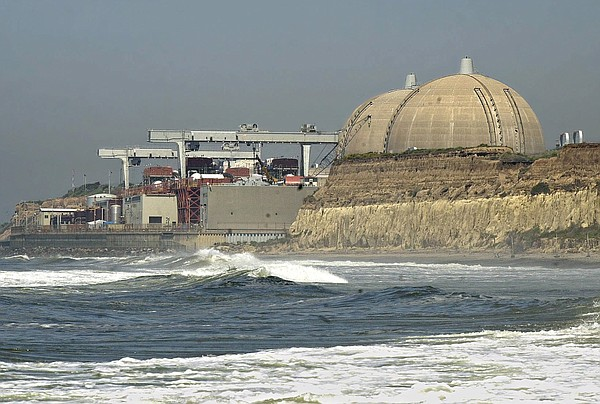 Pacific surf rolls in under the nuclear reactors of the San Onofre Nuclear Ge...