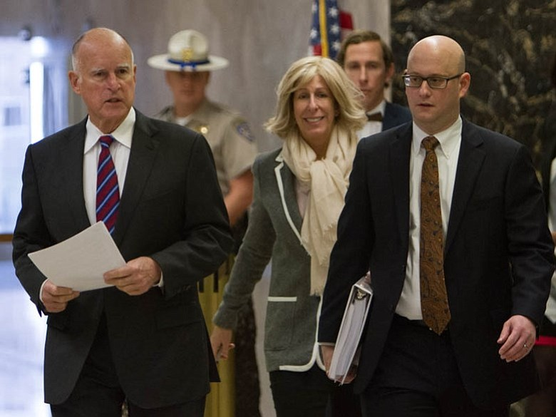 Gov. Jerry Brown walks through the state Capitol before releasing his January...