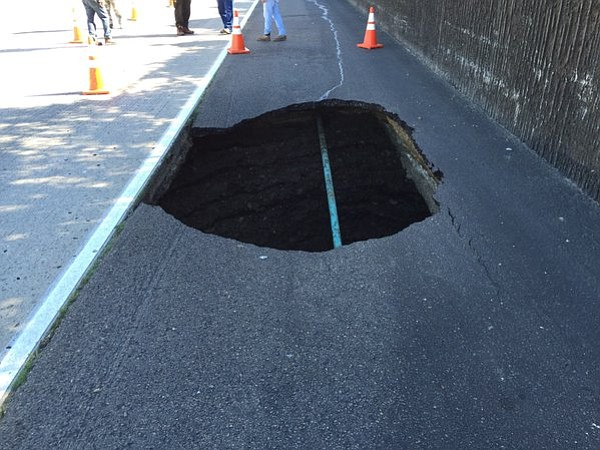 A large sinkhole on the right shoulder of eastbound Inter...