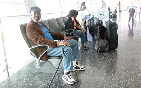 Tourist Milton Howard sits in San Diego's airport after l...