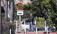 An armed officer is seen outside of the Naval Medical Center San Diego, Jan. 26, 2016. The Navy said authorities responded to a report of gunshots at a building on the campus.
