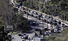 Traffic backs up as emergency vehicles arrive at the Naval Medical Center San Diego, Jan. 26, 2016. The Navy said authorities responded to a report of gunshots at a building on the campus.