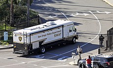A San Diego Police SWAT vehicle arrives outside of the Naval Medical Center San Diego, Jan. 26, 2016. The Navy said authorities responded to a report of gunshots at a building on the campus.