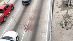 The Vía Rápida highway in Tijuana is stained with blood after a migrant was k...