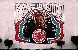 The Mafundi Institute mural is shown on a historic building in Watts. It's lo...