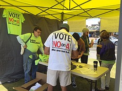 Opponents of Measure A staff an information booth in Carlsbad, Jan. 16, 2015.