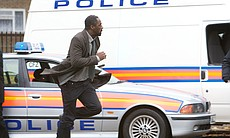 DCI John Luther (Idris Elba) arriving at the cr...