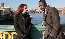 DCI John Luther (Idris Elba) talks to killer Al...