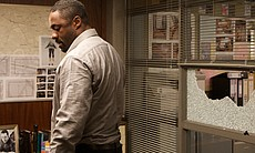 DCI John Luther (Idris Elba) in his office on t...