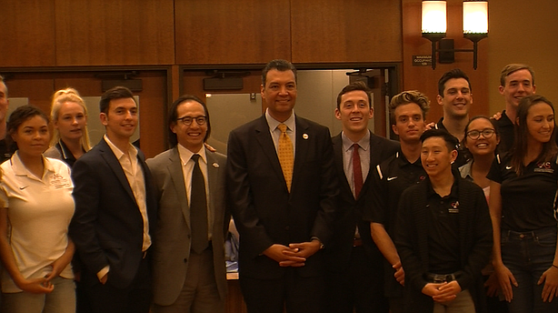 San Diego County Registrar of Voters Michael Vu and California Secretary of State Alex Padilla pose for a photo with San Diego State University students, Feb. 3, 2016.