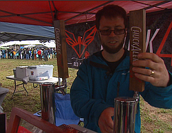 Grant Fraley pours a sour beer he brewed using a specific strain of bacteria,...
