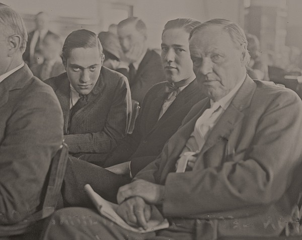 Nathan Leopold (left) and Richard Loeb (center), sitting in the courtroom wit...