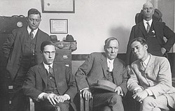Defense attorney Clarence Darrow (seated center) meets with his clients Natha...