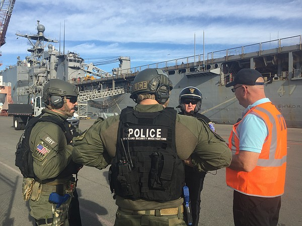 Law enforcement officials discuss response operations following an active sho...
