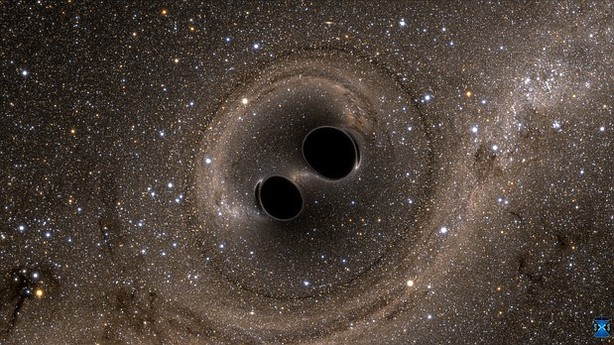 A simulated image of two black holes merging into one.