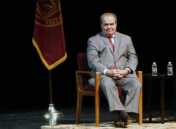 U.S. Supreme Court Justice Antonin Scalia waits during an...