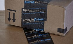 This photo shows Amazon.com boxes in Phoenix, June 4, 2014