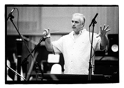 Oceanside-based composer Larry Groupé leads an orchestra during a recording s...