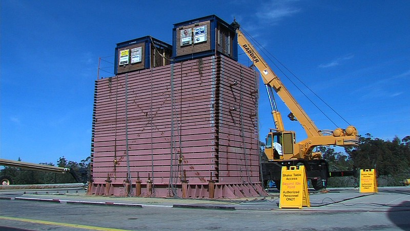 A container full of sand sits on the outdoor UCSD earthquake simulator. The c...