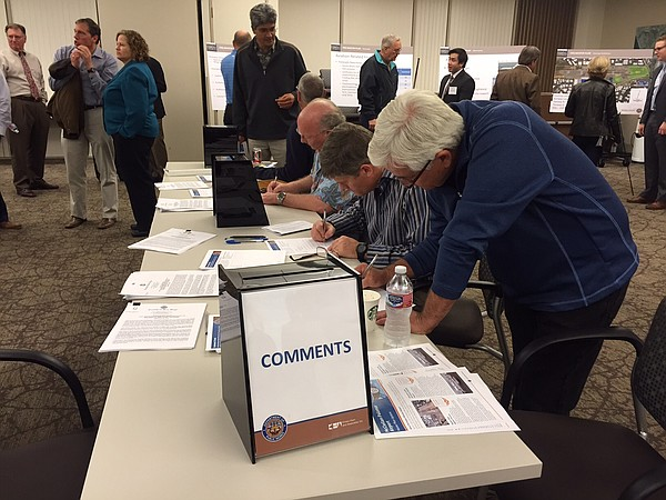 Residents write comments for an environmental report on plans to improve Palo...