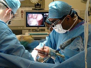 Surgeons operate on a patient, on June 6, 2010.