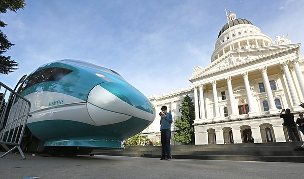 A full-scale mock-up of a high-speed train is displayed a...