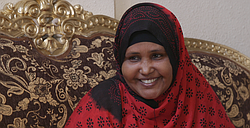Mariam Ali, a Somali refugee, talks in her San Diego living room about why it's important to her to vote in every election, Feb. 26, 2016.