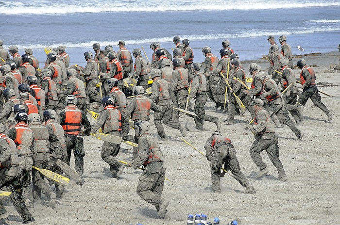 Navy seal death puts spotlight on training program kpbs navy seal candidates cover themselves in sand during one of the first phases sciox Choice Image