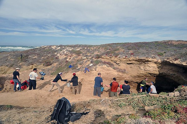 Cal State Los Angeles students excavating the cave on San Nicolas Island wher...