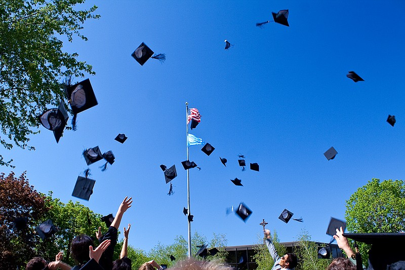 Graduation caps are thrown in the air, May 17, 2009.