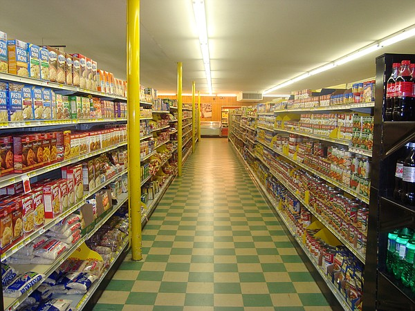 An aisle with canned food at a grocery story, March 23, 2...