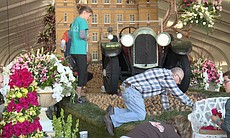 Nan Sterman helps decorate the Rose Parade's DO...