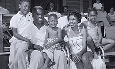 Jackie and Rachel Robinson with their children,...