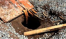 Wood plank removed from hole in the ground (tun...