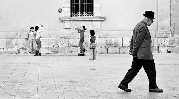 A man takes a walk as children play in the background, Ap...