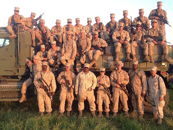 Capt. Brittney Boucher, front row in the center, stands w...