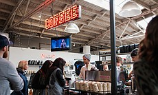 Customers make their order at James Coffee in L...