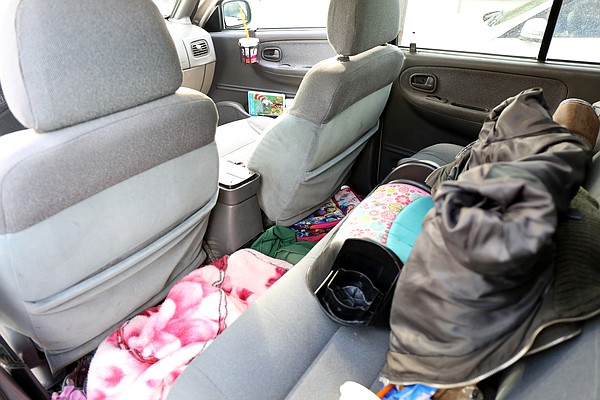 The inside of the Kia Sportage where Elena and her daught...