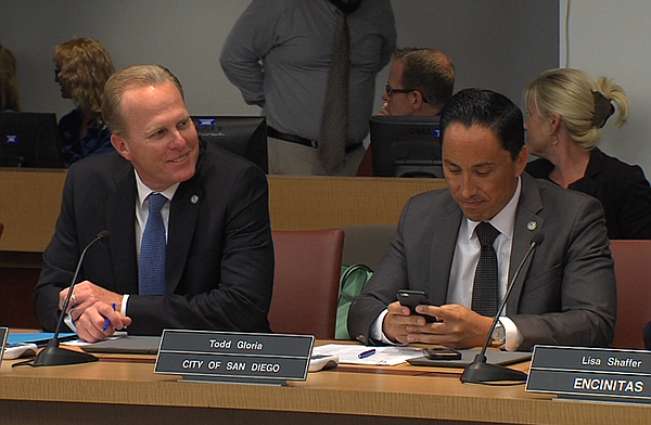 San Diego Mayor Kevin Faulconer, left, and City Councilma...